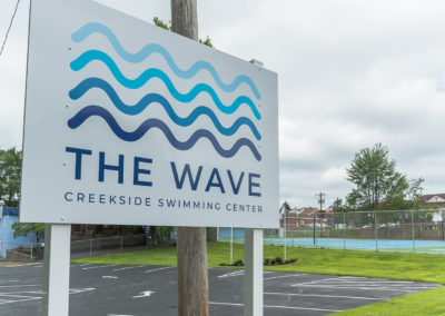 The Wave swimming center at Creekside entrance sign