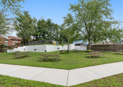 Picnic tables on the grass at Creekside Apartments in Bensalem
