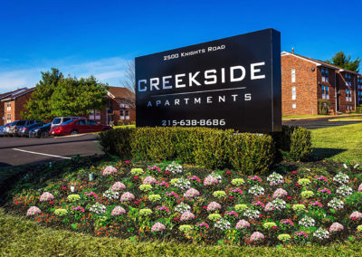 Entrance sign at Creekside Apartments