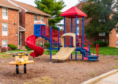 Playground area with a multi-colored jungle gym