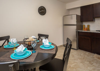 Kitchen and dining area at Creekside Apartments in Bensalem